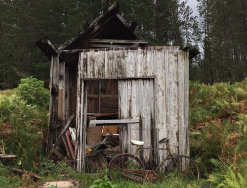 rusty bike against broken shed, Glen Etive