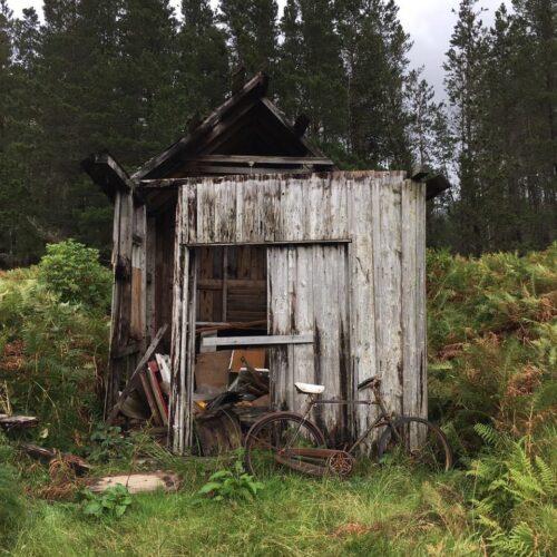 rusty bike against broken shed, Glen Etive