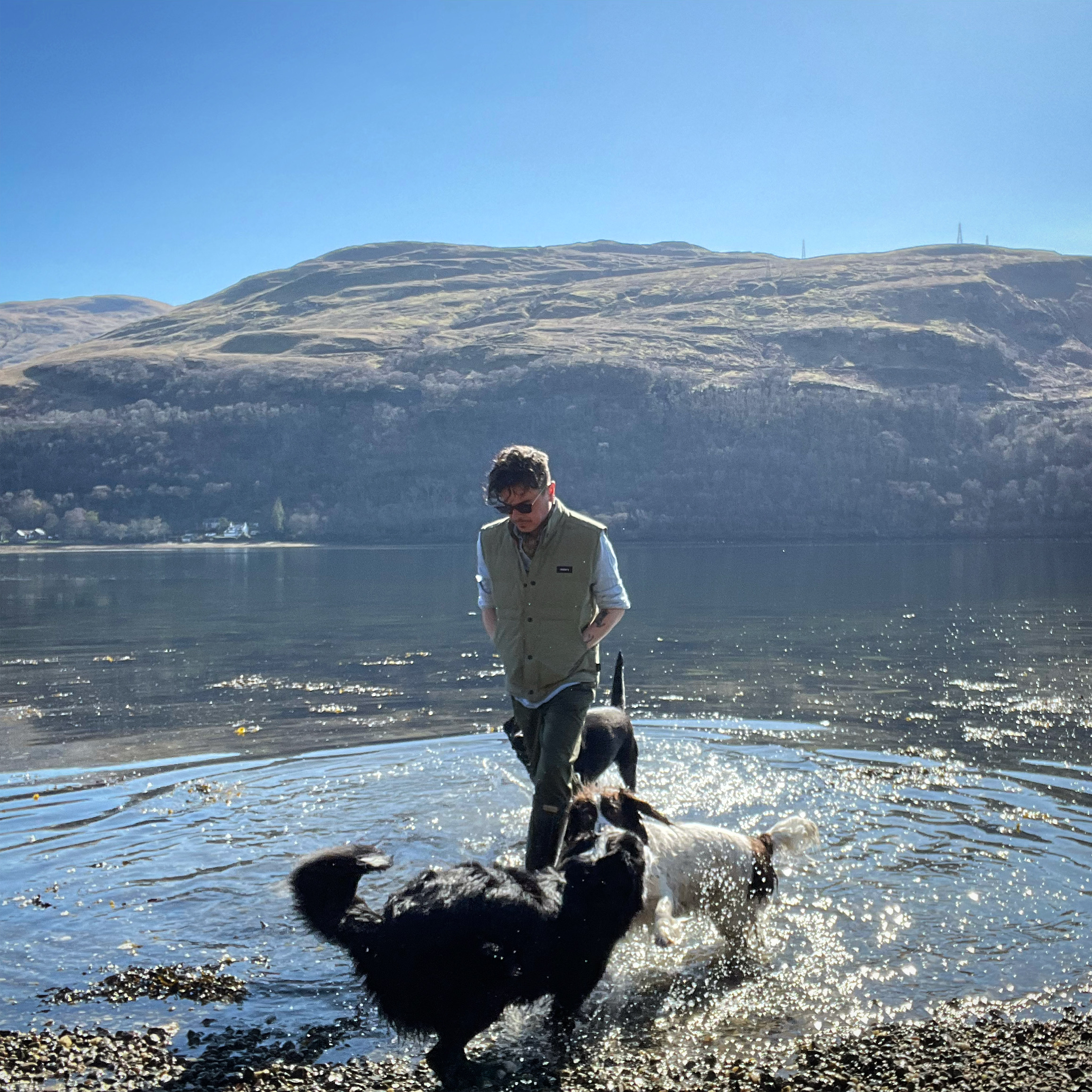 Ali Campbell with dogs in Loch Long